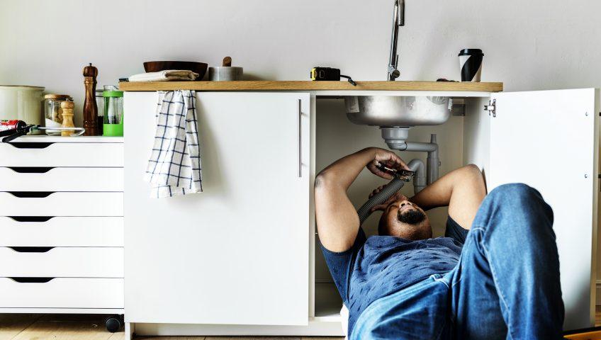 Plumber under sink